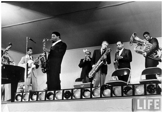 sonny-rollins-5r-dizzy-gillespie-4r-and-gerry-mulligan-3r-ben-webster-2r-at-the-monterey-jazz-festival-by-nat-farbman-1958.jpeg